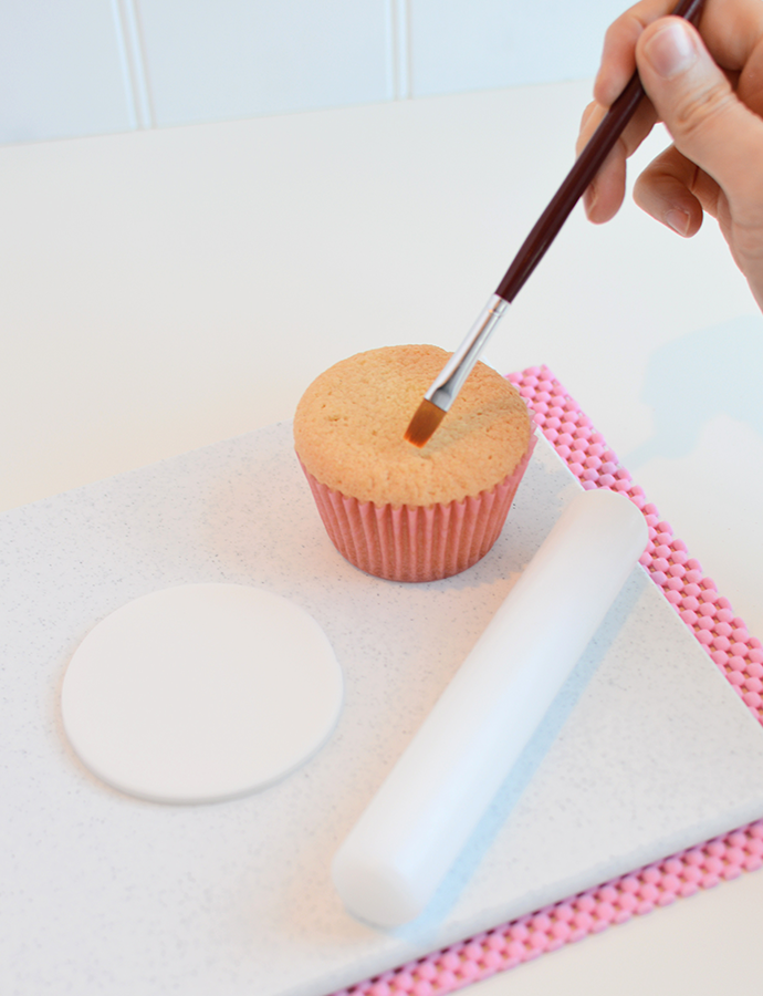 Applying-Icing-onto-Cupcake