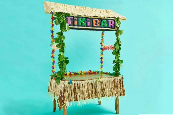 Tiki Bar frame decorated with sign, leaf garlands and hibiscus flower garlands.