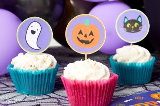 Halloween cake toppers on cupcakes with pink and gold wrappers