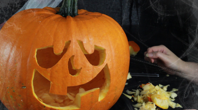 Pumpkin carved out with a silly face
