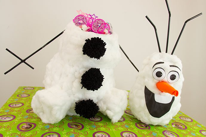 Papier mache Olaf filled with gifts