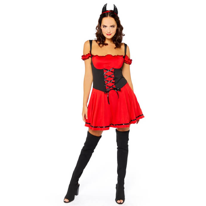Woman with dark hair wearing a sexy red devil costume with a corset, horns on her head and thigh high stockings