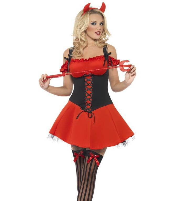 A woman wearing a devil fancy dress costume with corset