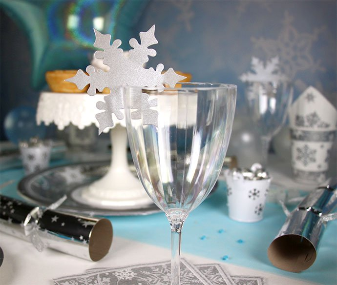Snowflake place card holder perched on a wine glass