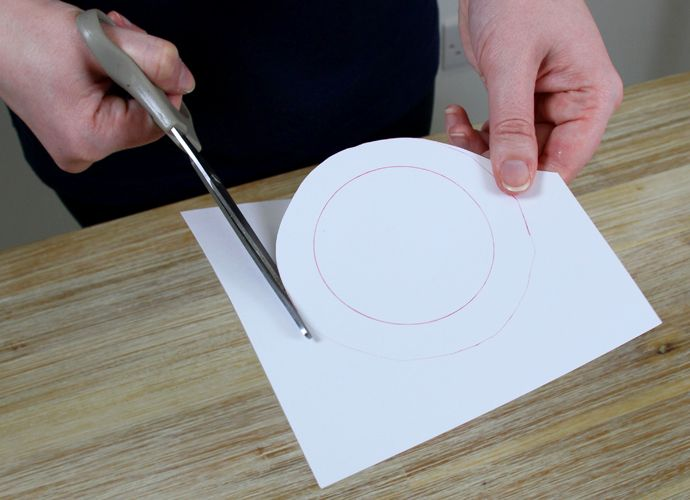 Cutting a circle from a piece of white card
