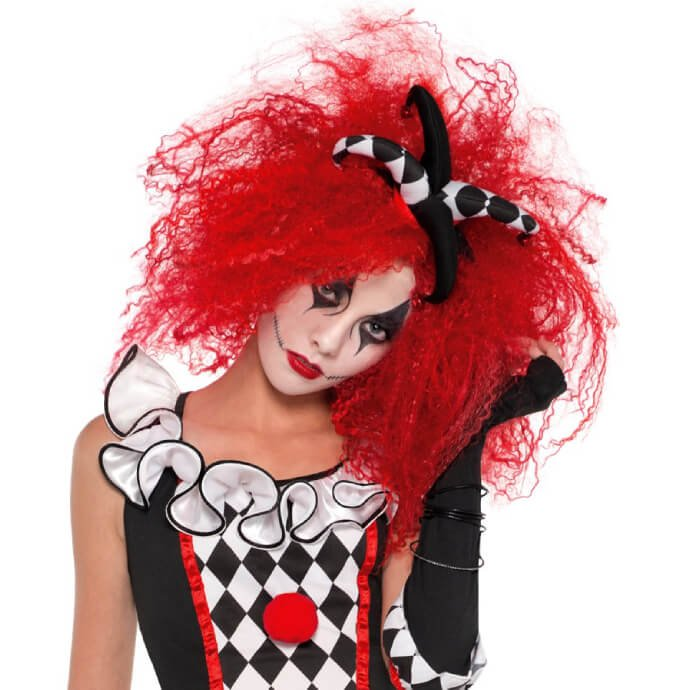 Woman in harlequin costume with red clown hair