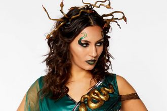 Medusa fancy dress blog header image showing a woman in Medusa costume with snake headband and makeup