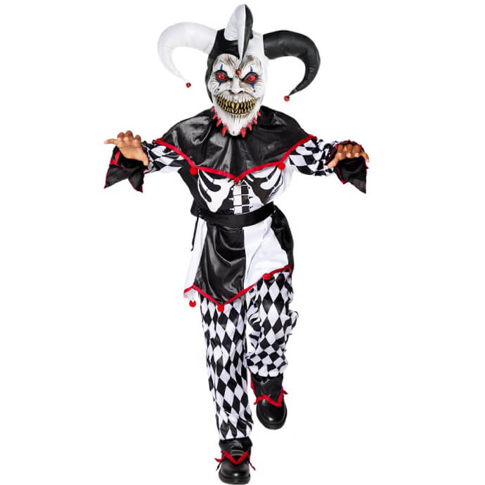 Young boy wearing a black and white sinister jester costume with ribcage showing, a scary mask and classic jester hat