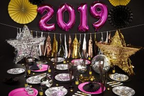 Pink 2019 balloons over a New Year's Eve party table arrangement