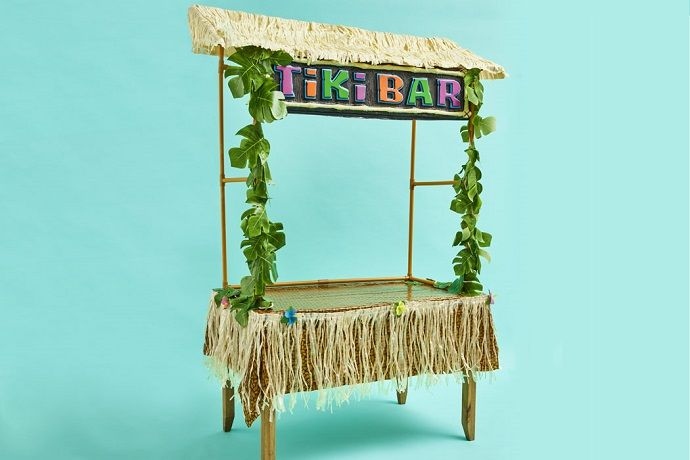 A Tiki Bar frame complete with sign and leaf garlands.