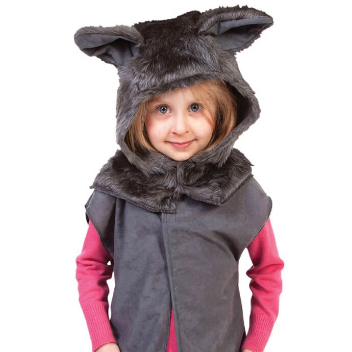 A small girl is wearing a wolf costume hat and tabard