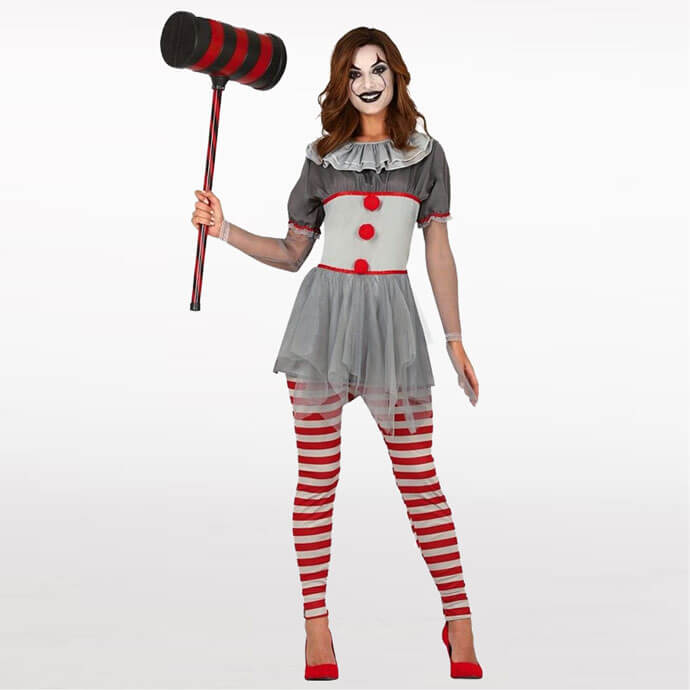 Woman dressed in Pennywise costume with red tights, clown makeup and a giant hammer