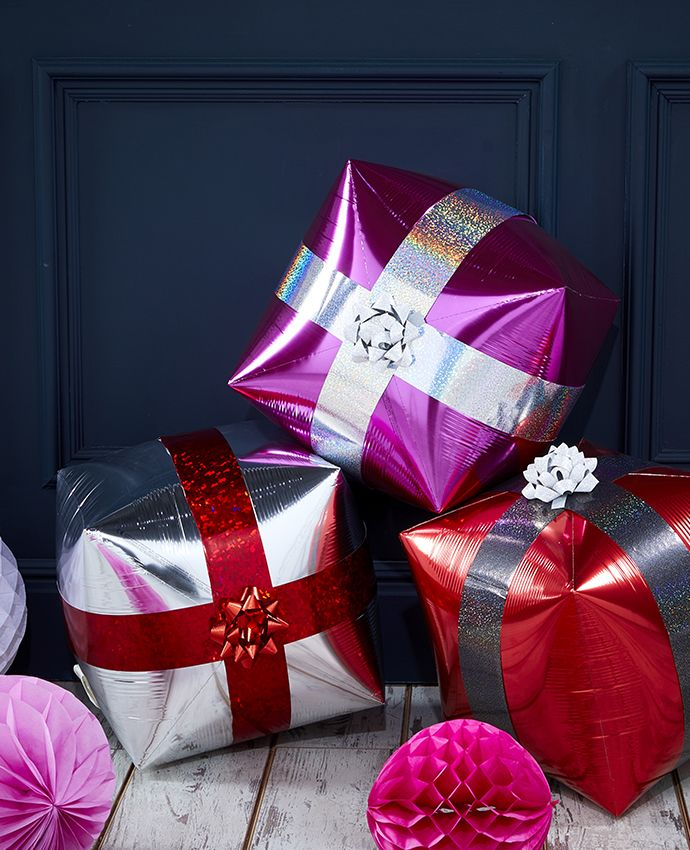 Christmas decoration made from cube-shaped balloons to look like presents.