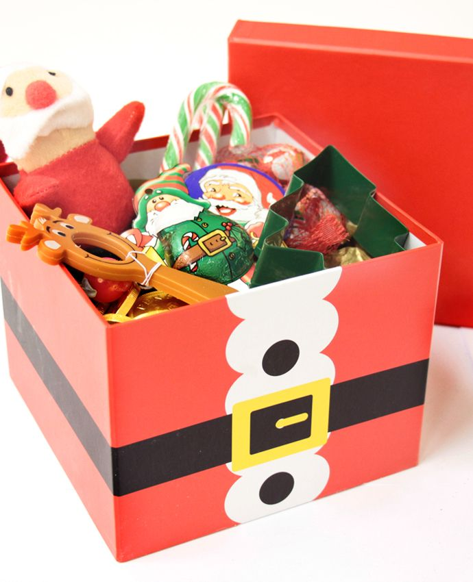 Sweets and toys in a Christmas Eve box