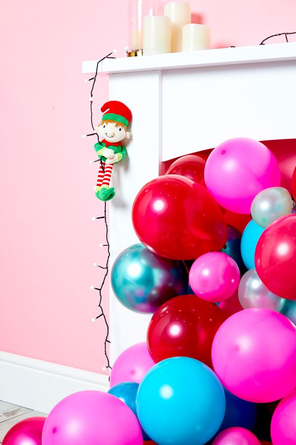 Elf on the Shelf idea - Abseiling down the fireplace on a string of Christmas lights