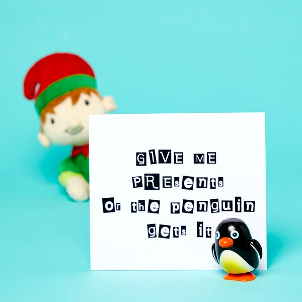 Elf on the Shelf idea - Holding a penguin beside a ransom note