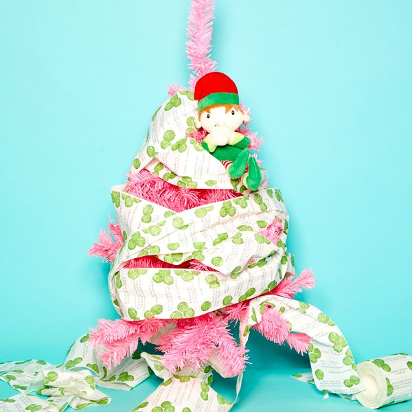 Elf on the Shelf idea - Wrapping a Christmas tree in toilet paper