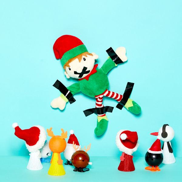 Elf on the Shelf idea - Edward the Elf strapped to a wall