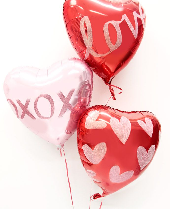 Love heart balloons decorated with glitter