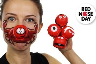 Woman with Red Nose Day face paint also wearing a Red Nose and holding several others in one hand. The logo for Red Nose Day is in the corner of the image.