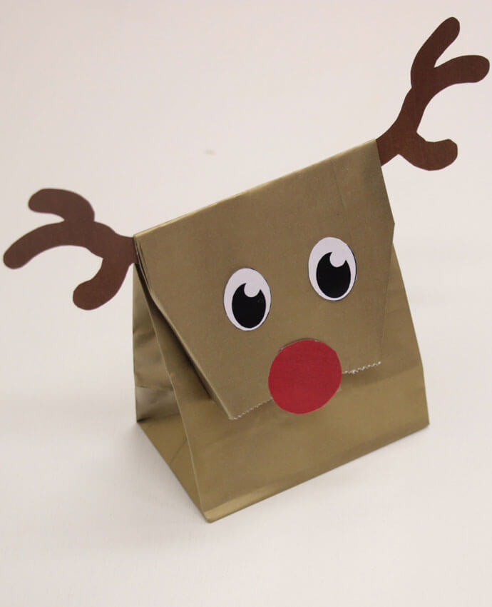 Gold party bag decorated to look like a reindeer