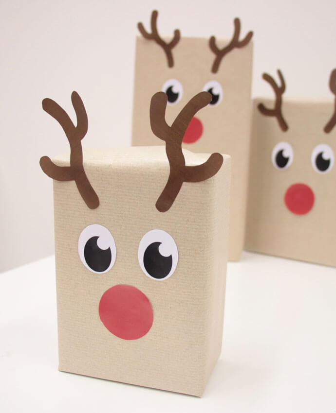 Christmas presents with reindeer wrapping paper