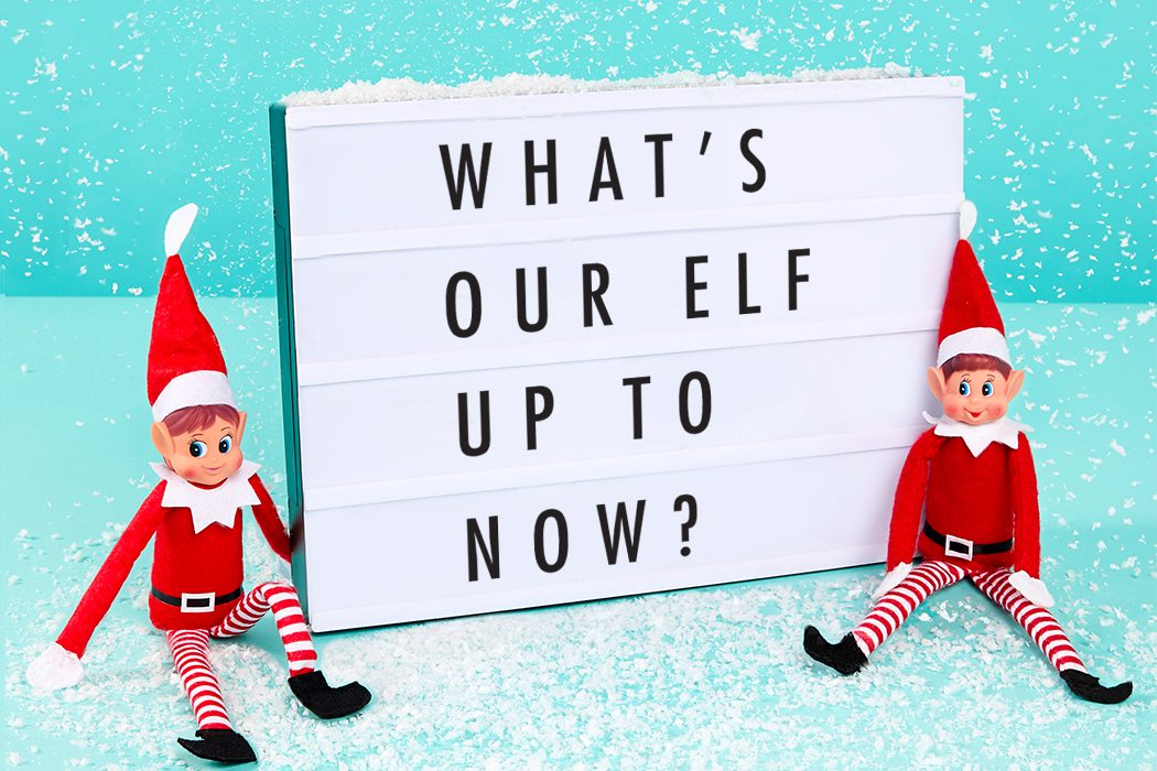 Elf on the Shelf sitting in the snow