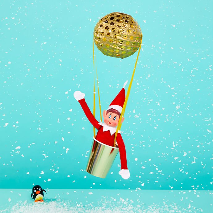 Elf on the Shelf flying off to the North Pole in a balloon