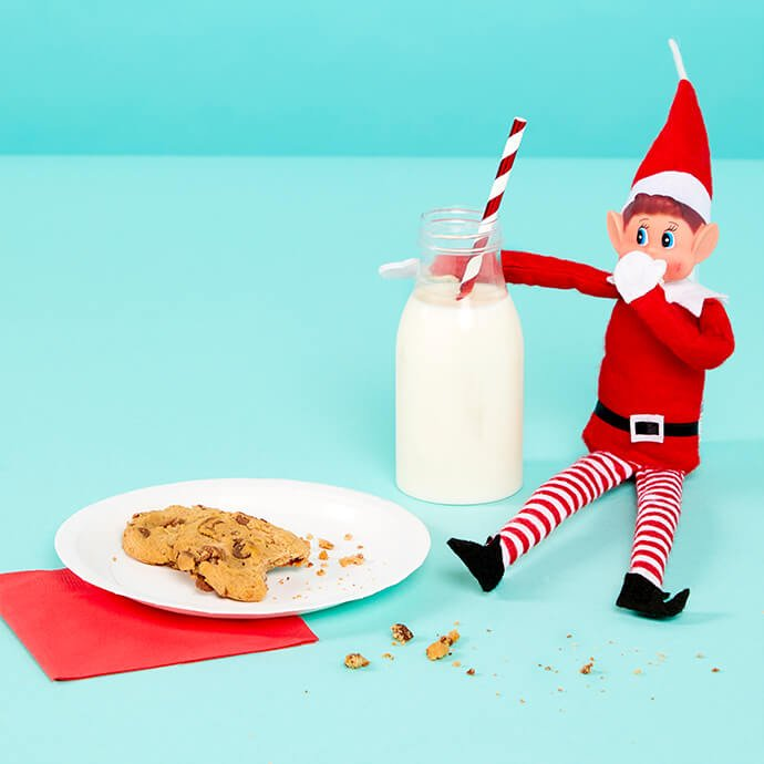 Elf on the Shelf enjoying some milk and cookies