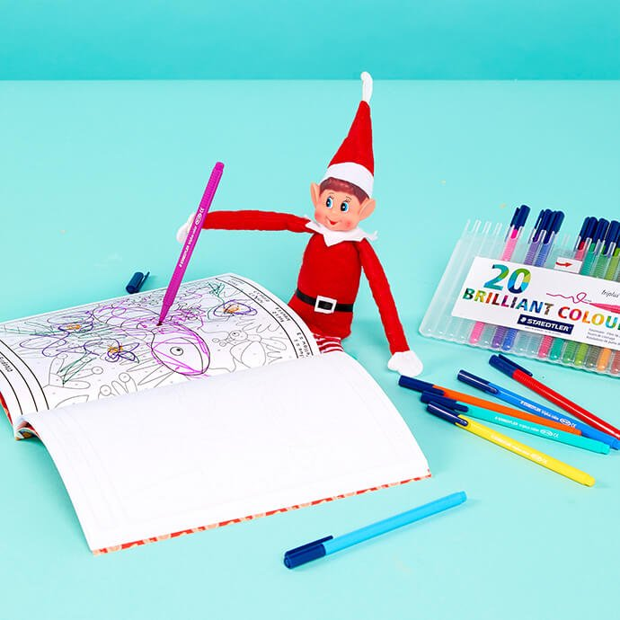 Elf on the Shelf doodling in a notebook
