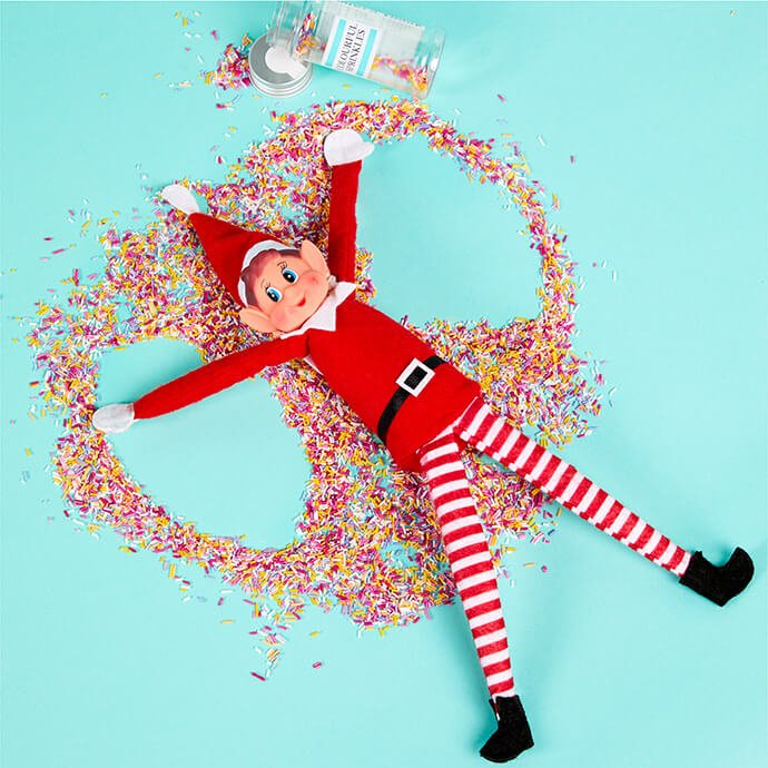 Elf on the Shelf making a snow angel