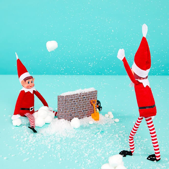 Elf on the Shelf having a snowball fight