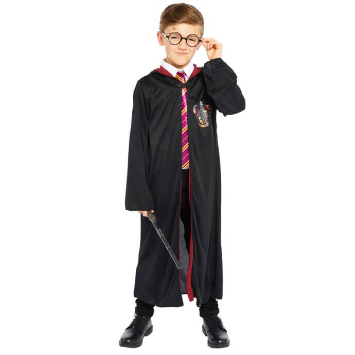 Child wearing a Harry Potter costume with glasses and wand