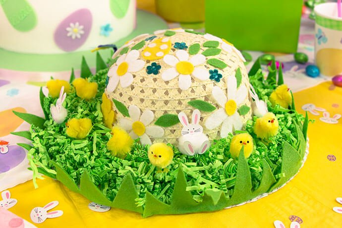 Yellow Easter bonnet decorated with chicks, green paper and flower cut-outs