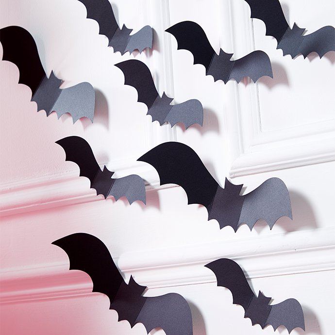 Black paper bat cutouts for wall decoration