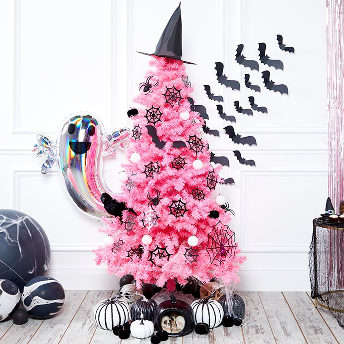 Pink Halloween tree decorated with a witch's hat, paper bats, pumpkins, spiders and a raven