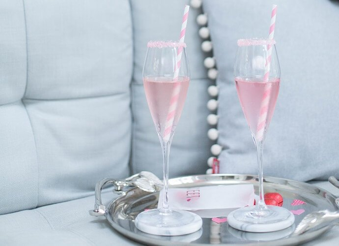 Two glasses with rose gin drink for a Valentine's day party