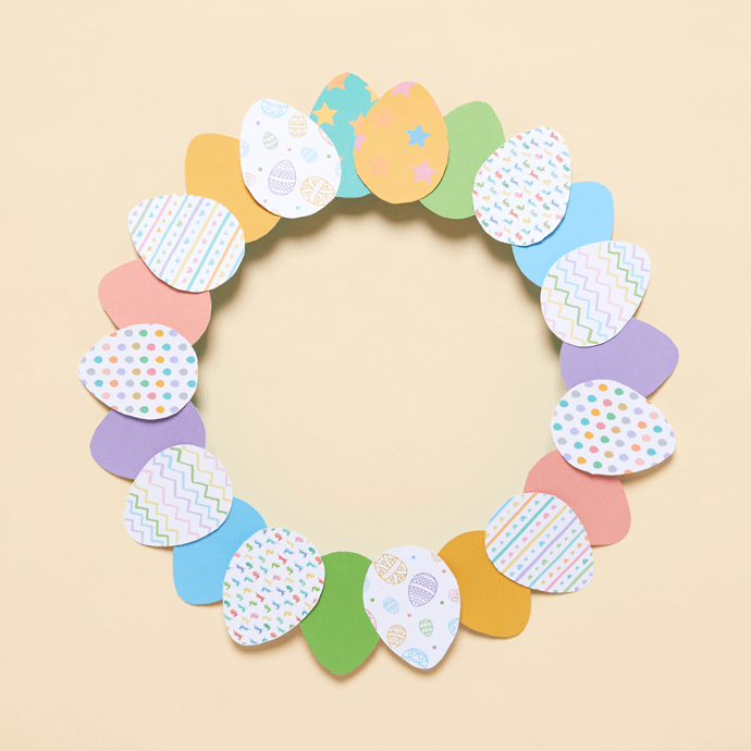 Completed paper Easter wreath made from a paper plate and some egg printables