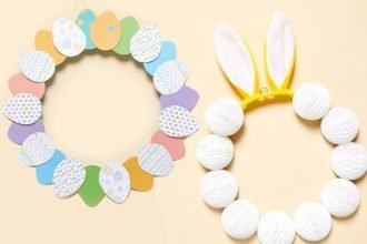 Two Easter Wreath decorations placed side by side, one with coloured paper eggs and the other with bunny ears and pom poms
