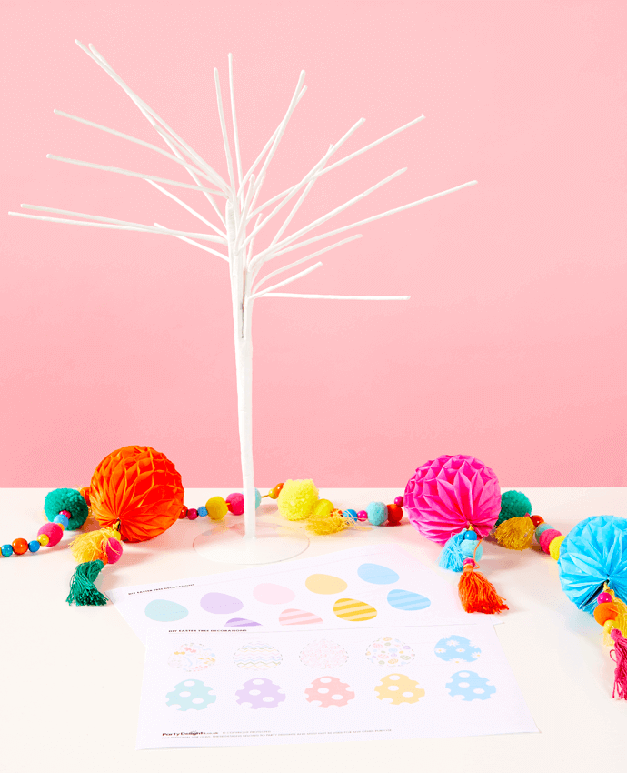 Party Delights white Easter tree shown with pom pom garlands and printable 3D eggs