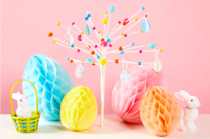 A fully decorated Easter tree surrounded by bunnies in baskets and honeycomb eggs