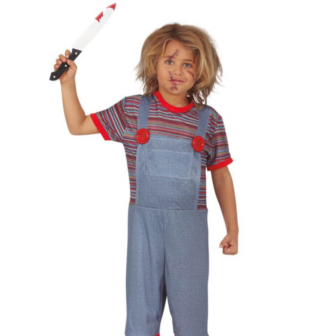 A young boy with long blonde hair wears a Chucky costume with scars on his face and a knife in his hand