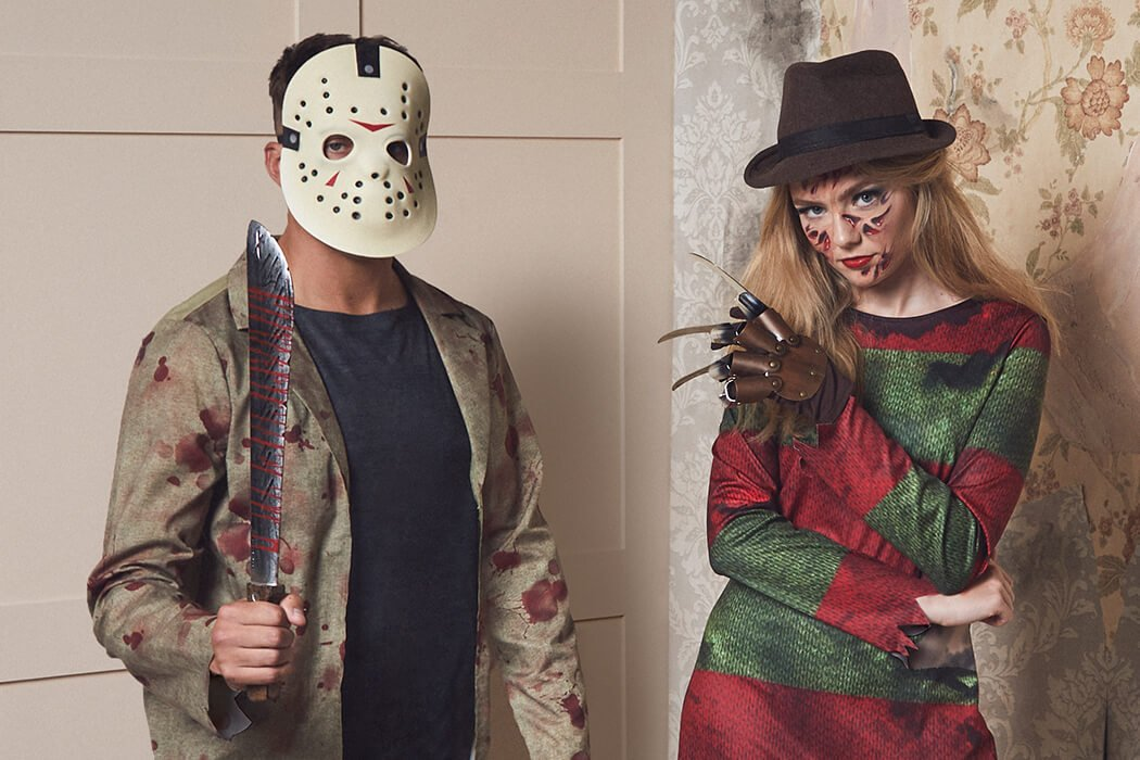 A man wearing a Jason Voorhees costume stands threatening next to a woman in a Freddy Krueger outfit