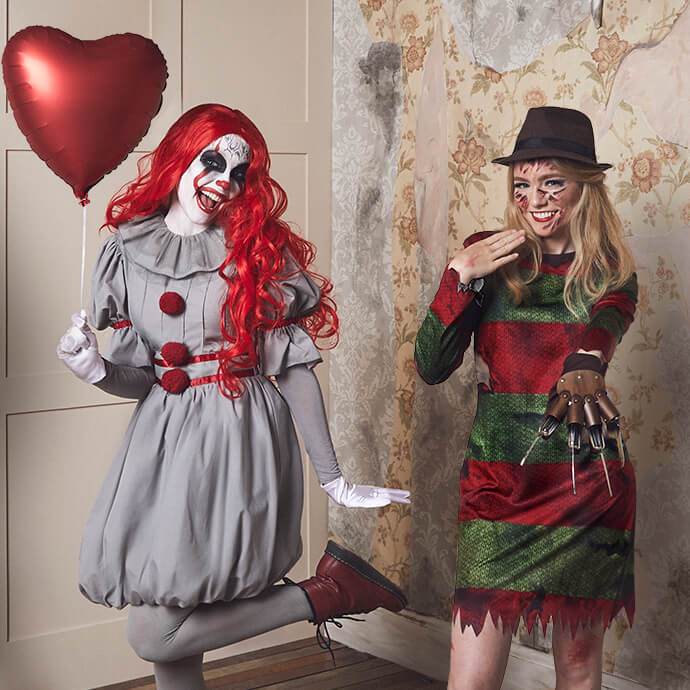 A female version of Pennywise the clown holding a heart shaped red balloon while a female version of Freddy Krueger shows off her bladed glove