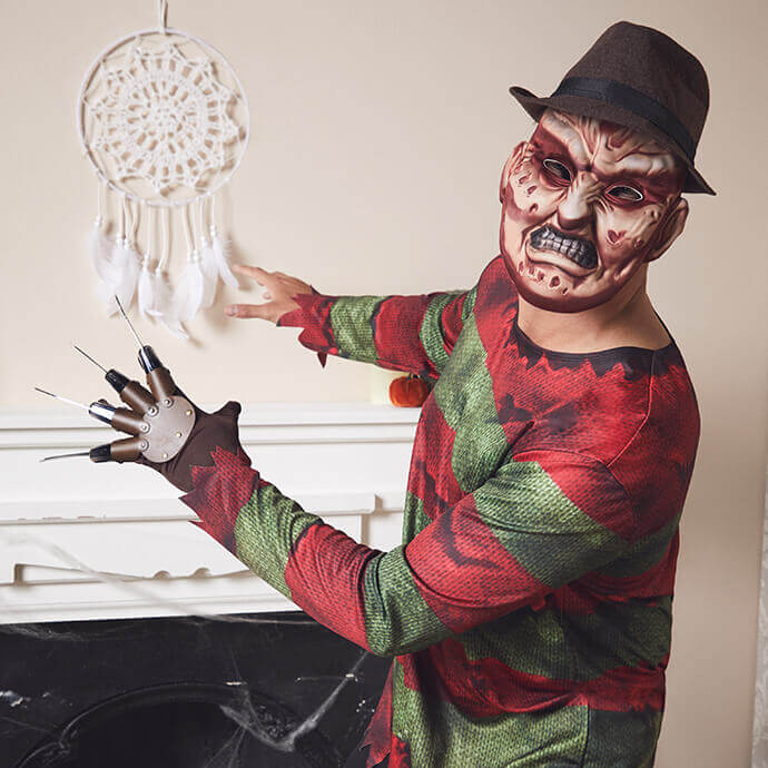 A man in a Freddy Krueger costume and mask is afraid of his only weakness - a dreamcatcher