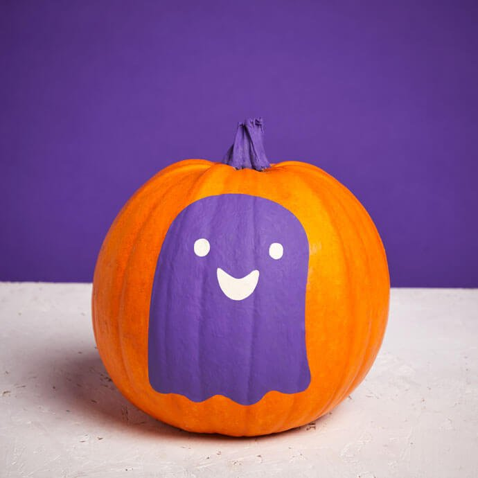 Painted purple ghost on a pumpkin with a purple stalk