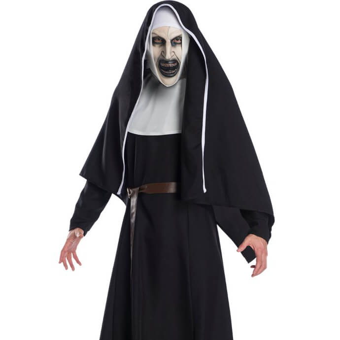 Someone wearing a costume of Valak from The Nun is staring menacingly into the camera